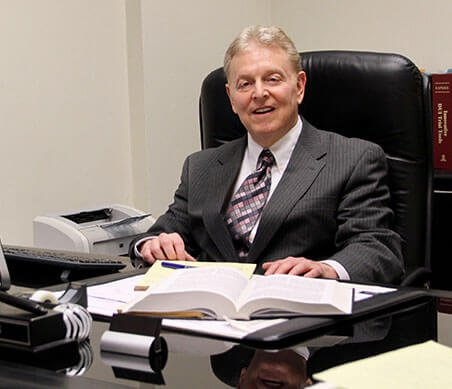 Attorney Dennis Levin at his desk