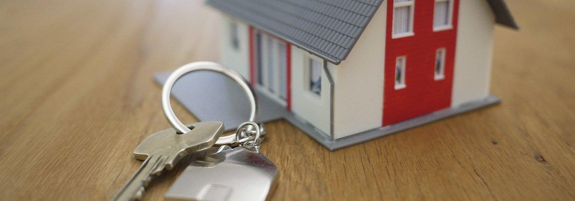 Keys sitting next to a plastic house