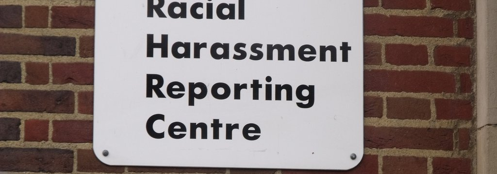 Signage says Racial Harassment Reporting Centre