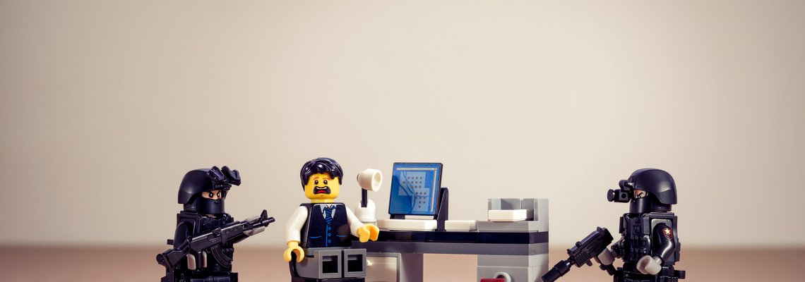 Lego Figure Working at an Office Desk