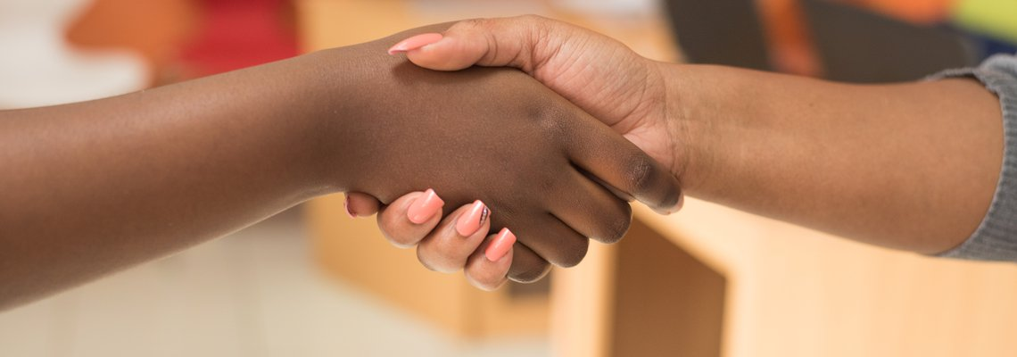 Canva - Two People Shaking Hands.jpg