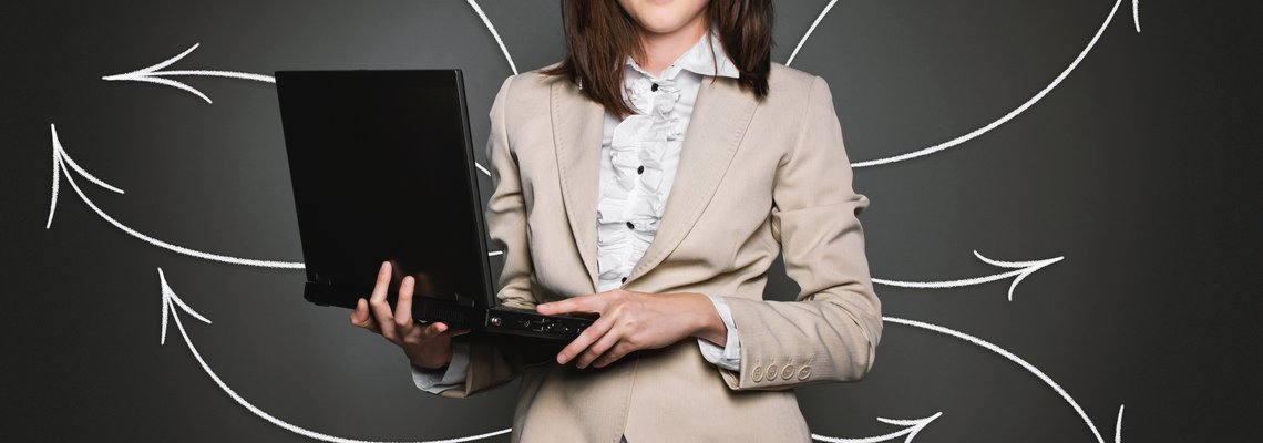 Woman Holding a Laptop With Arrows Flying Around Her