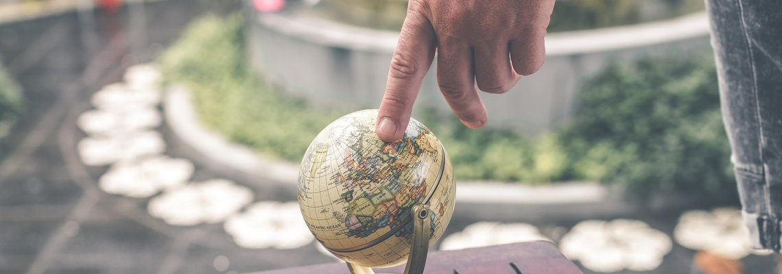 Finger Pointing at the Globe