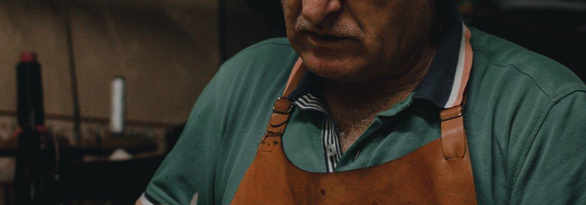 Elderly man Doing Wood Carving