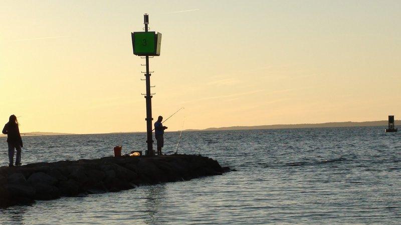 Person fishing at sunrise