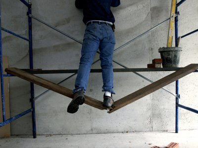 Painter standing on a breaking step