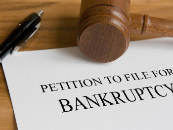 Gavel on top of Petition to File For Bankruptcy