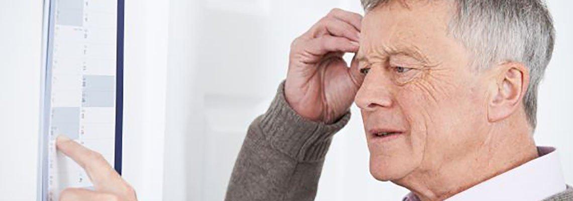 Elderly man confused by his checklist