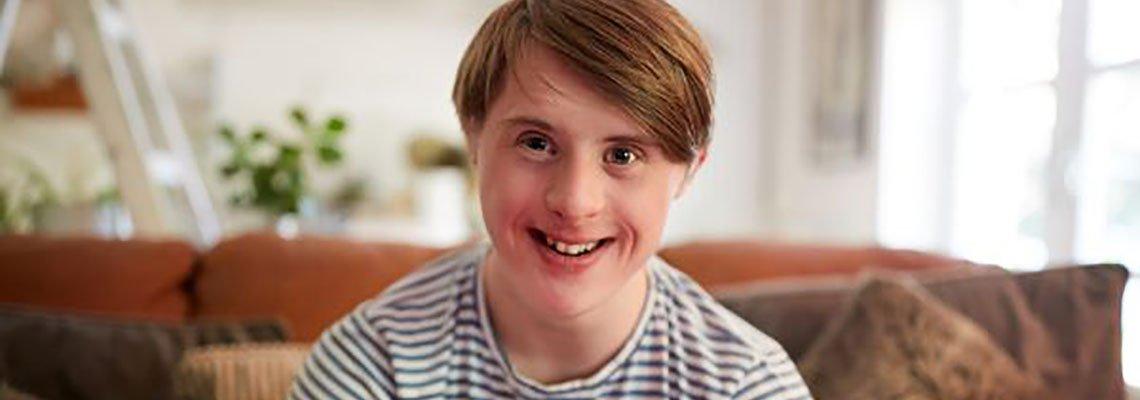 Disabled man smiling at camera