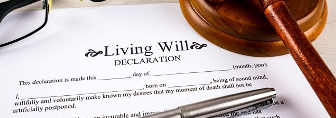 Living Will Declaration documents with a pen