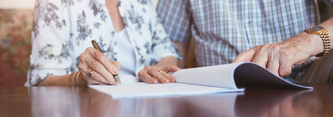 Elderly Couple filling out documents