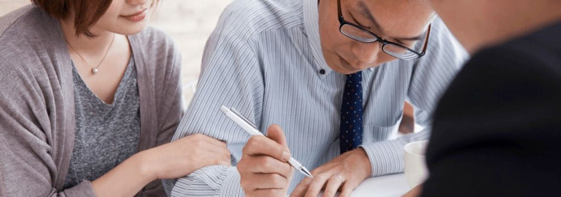 A Couple Signing Legal Documents
