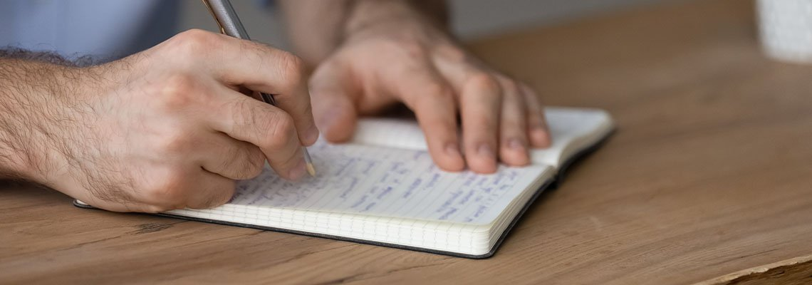 Man writing a will in his notebook
