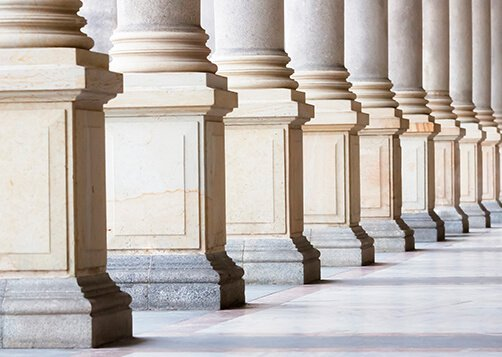row of large stone columns