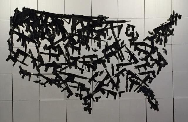 Hanging sculpture of guns