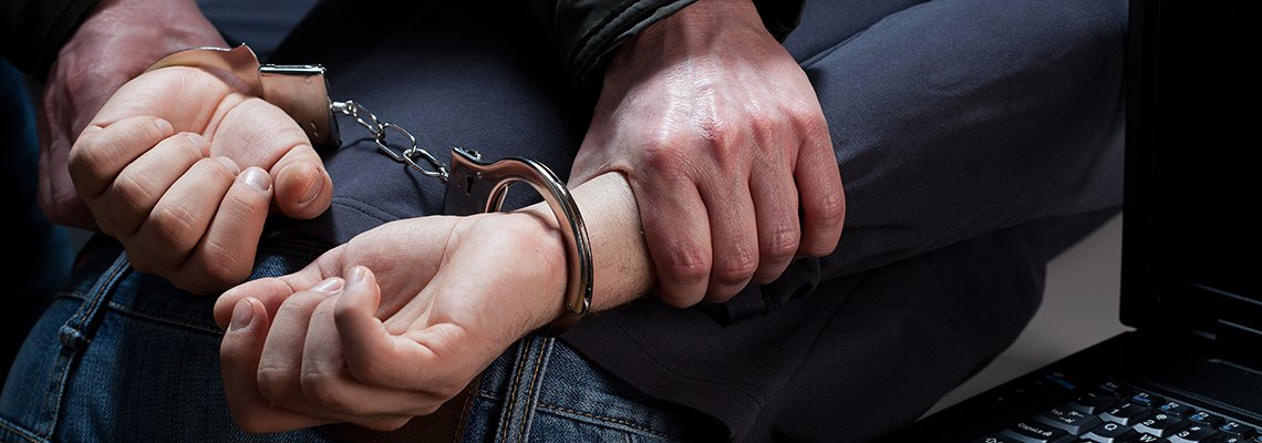 Man leaned over being handcuffed