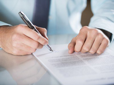 Business contract being signed