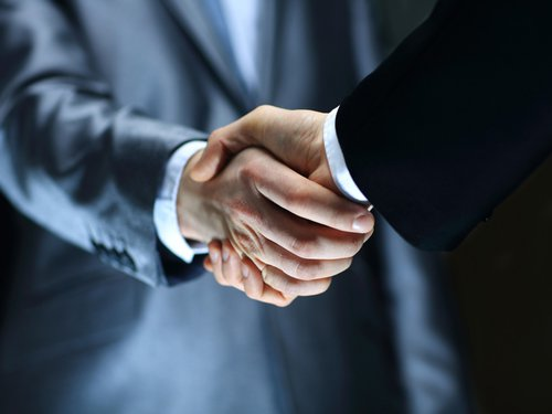 Two business-people shaking hands