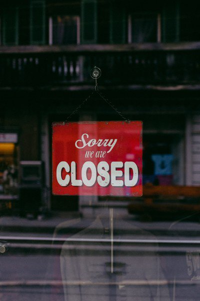 """Red and white """"Sorry, we are closed"""" sign"""