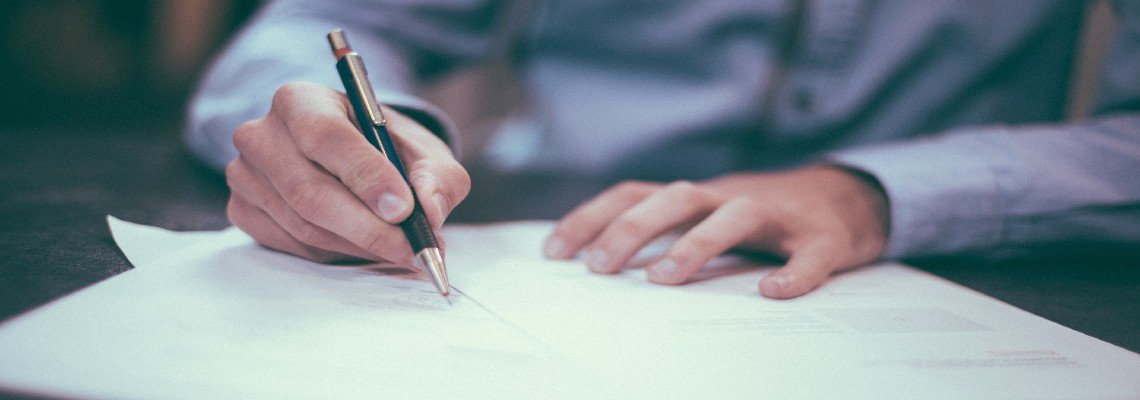 Man Writing on Papers