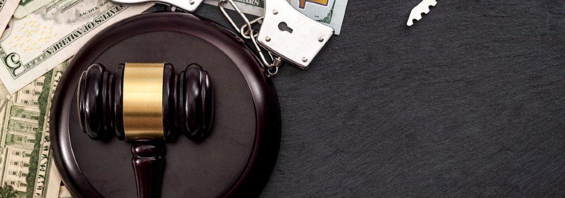 Handcuffs and Gavel Sitting On Cash