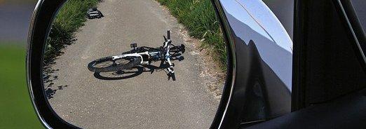 bike lying on ground in car mirror