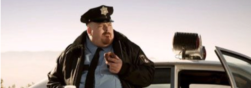 Cop Eating Donut