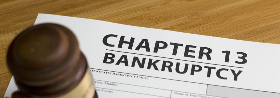 Gavel resting on chapter 13 bankruptcy documents