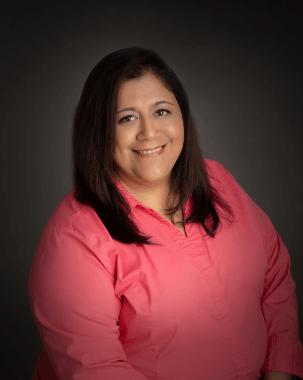Receptionist Edna Perez Smiling