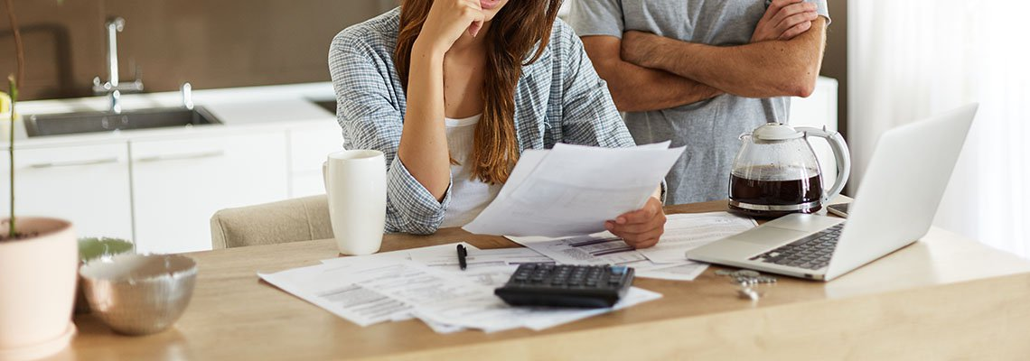 Couple going over bankruptcy documents in their kitchen