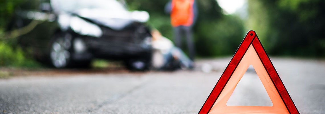 Orange traffic marker set out in road after an accident