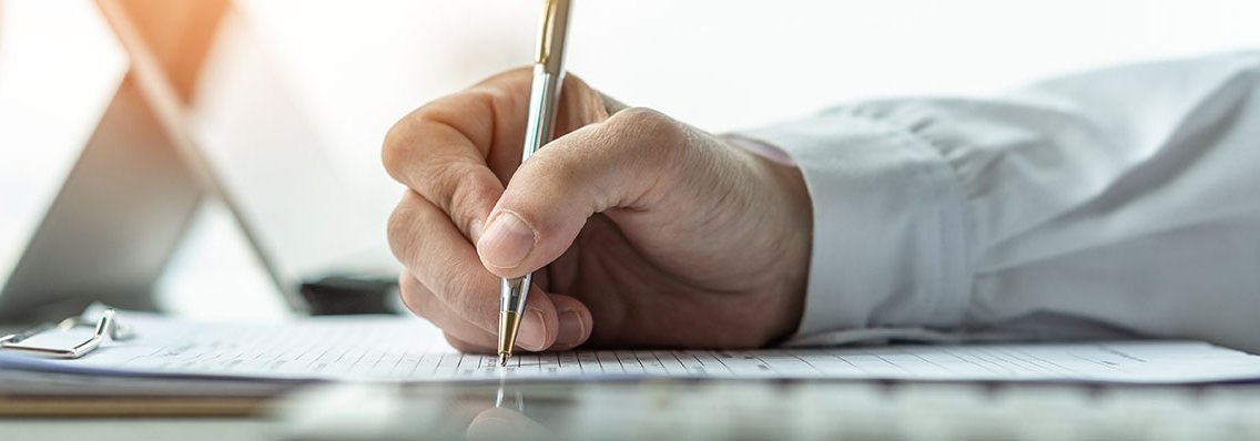 Man filling out insurance paperwork