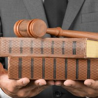 Man holding books and gavel