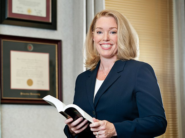 Attorney Jennifer Walker holding a book