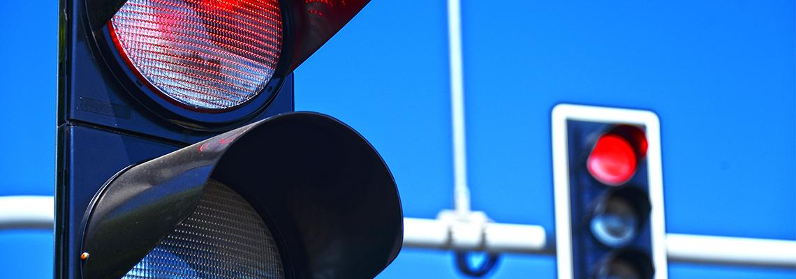 Red traffic lights over blue sky
