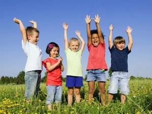 Group of children happy in a field