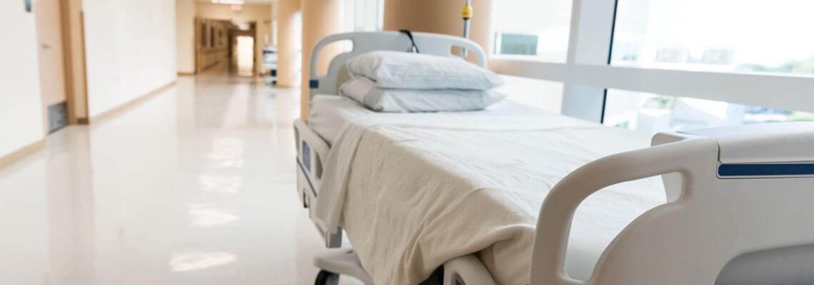 Hospital bed in a hallway