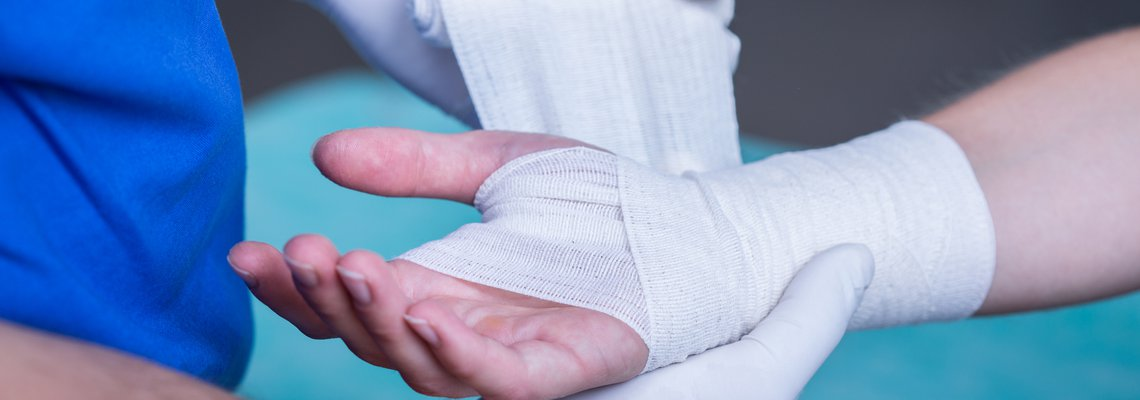 Doctor wrapping a wrist in bandages