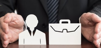 Hands surrounding a cutout of a businessman and briefcase