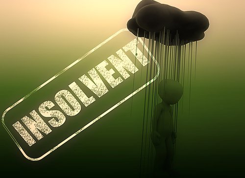 Man being rained on by the word Insolvent