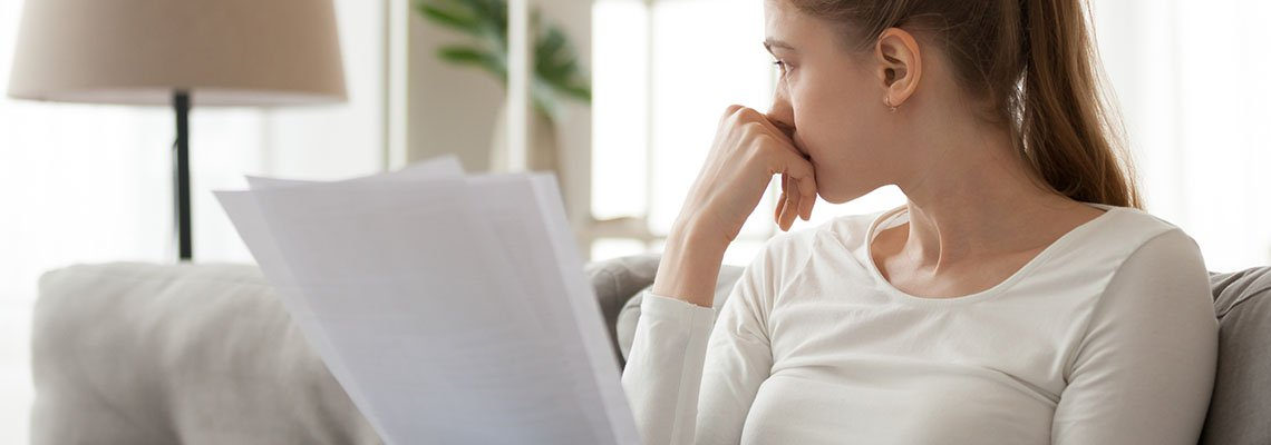 Frustrated woman with documents in her hands