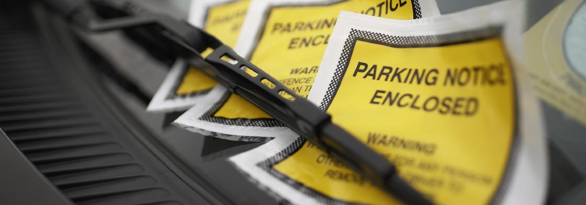 Three Parking tickets on a windshield