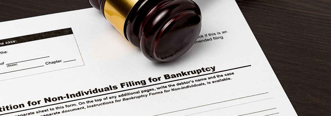 Gavel resting on a document to file bankruptcy