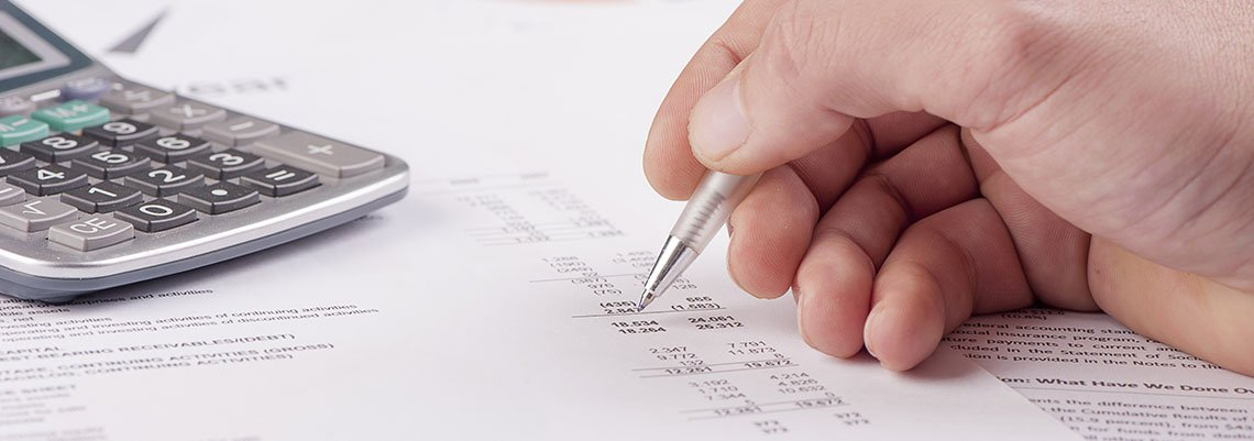 Filling out tax documents with a calculator