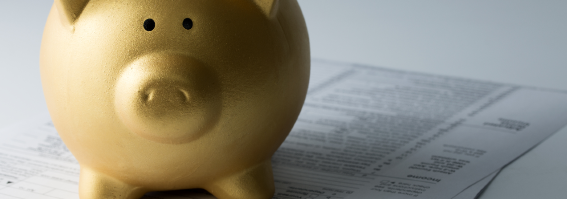 Small piggy bank on documents