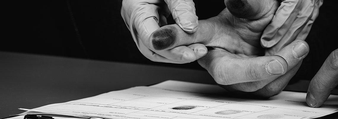Police taking fingerprints of a man