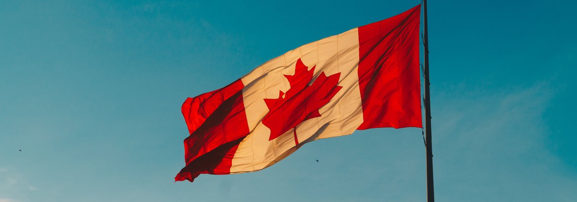 Canadian flag flying with clear blue skys