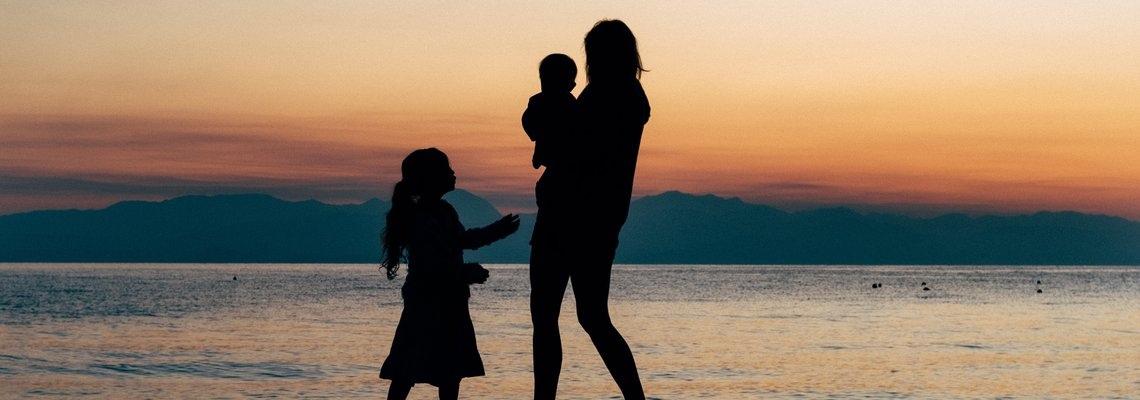 silhouette of family at sundown