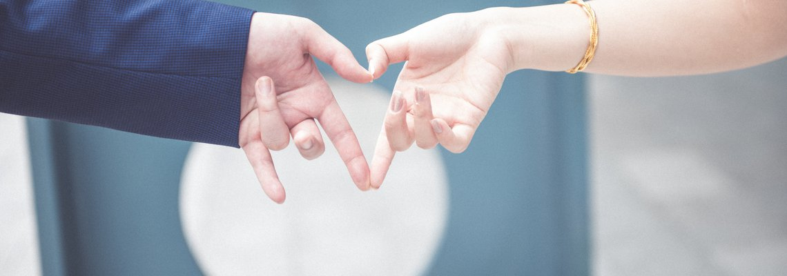 Couple making a heart with their hands