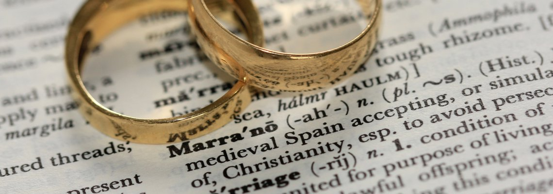 Two rings intertwined over dictionary definition if marriage